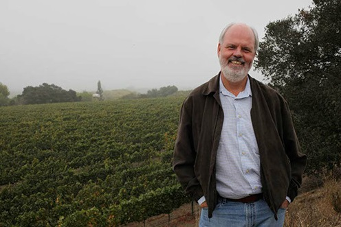 John Peterson at his vineyard on a typically foggy day